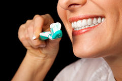 Woman healthy teeth closeup on black Stock Images