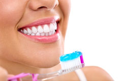 Woman with healthy teeth holding a tooth-brush Royalty Free Stock Photo