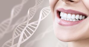 Woman with healthy teeth and smile among DNA chains. Over beige background royalty free stock image