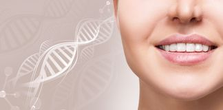 Woman with healthy teeth and smile among DNA chains. Over beige background Stock Photography