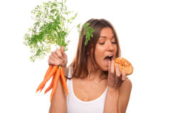Woman Healthy vegeterian organic carrots, bun roll Stock Photos