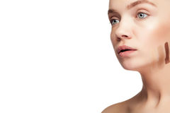 Woman with healthy young skin and three cream mark Royalty Free Stock Image