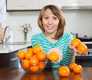 Woman with heap of mandarins Stock Image
