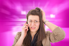 Woman hearing bad news over phone. Business woman with glasses hearing bad news over phone Royalty Free Stock Images