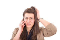 Woman hearing bad news over phone. Business woman with glasses hearing bad news over phone Royalty Free Stock Photos