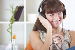 Woman hearing music Royalty Free Stock Photography