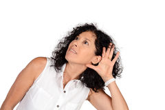 Woman hearing something. Portrait of beautiful woman hearing something. Isolated white background Royalty Free Stock Photo