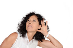 Woman hearing something. Portrait of beautiful woman hearing something. Isolated white background stock photography
