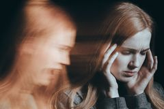 Woman hearing voices Stock Photo
