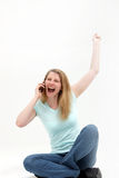 Woman hears the good news over the phone Royalty Free Stock Images