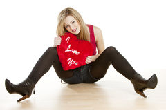 Woman with heart. Sitting young woman with heart Stock Image