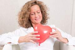 Woman with heart balloon Royalty Free Stock Photo