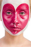 Woman with heart face painting isolated Royalty Free Stock Photography