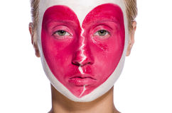 Woman with heart face painting isolated Stock Photography