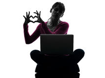 Woman heart gesture computing laptop computer silhouette Stock Photography