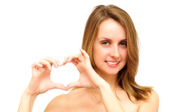 Woman heart gesturing Stock Photos