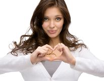 Woman heart gesturing Royalty Free Stock Photography