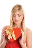 Woman with heart gift Stock Photography