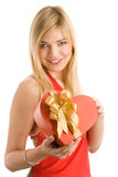 Woman with heart gift Stock Images