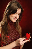 Woman with a heart gift Stock Images
