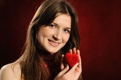 Woman with a heart gift Royalty Free Stock Photos
