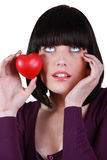 Woman with heart in hand Stock Images