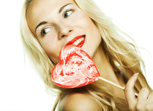 Woman with heart lolly pop Stock Photography