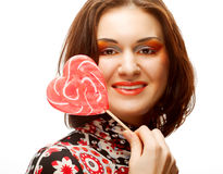 Woman with heart lolly pop Royalty Free Stock Photography