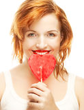 Woman with heart lolly pop Stock Photo
