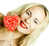 woman with heart lolly pop Stock Photos