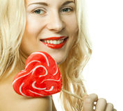 woman with heart lolly pop Royalty Free Stock Image