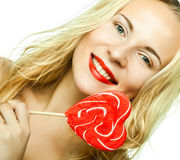 woman with heart lolly pop Stock Images