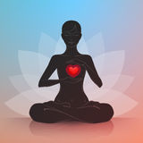 Woman with heart. Lotus position Royalty Free Stock Photography