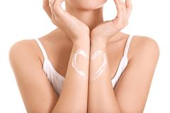 Woman with heart made of body cream royalty free stock images