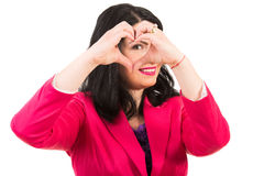 Woman heart made in front of her eye Royalty Free Stock Photography