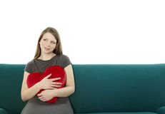 Woman with a heart pillow Stock Photo