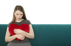 Woman with a heart pillow Royalty Free Stock Image