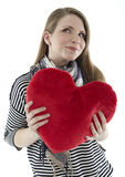 Woman with a heart pillow Stock Images