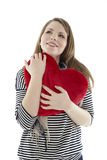 Woman with a heart pillow Royalty Free Stock Photography
