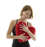 Woman with heart pillow Royalty Free Stock Images