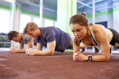 Woman with heart-rate tracker exercising in gym Royalty Free Stock Photography