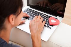 Woman with heart shape and laptop Stock Photo