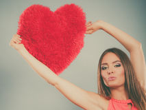 Woman with heart shape pillow. Valentines day love Stock Photos