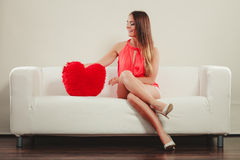 Woman with heart shape pillow. Valentines day love Royalty Free Stock Image
