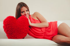 Woman with heart shape pillow. Valentines day love Royalty Free Stock Photography