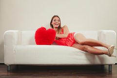 Woman with heart shape pillow. Valentines day love Stock Photo