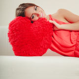 Woman with heart shape pillow. Valentines day love Stock Photography