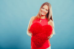 Woman with heart shape pillow. Valentines day love Royalty Free Stock Photo