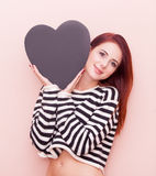 Woman with heart shape toy Stock Photos