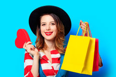 Woman with heart shape toy and shopping bags Stock Photos